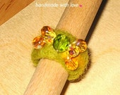 Wooly felted ring in green and amber