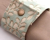 Budding Branch Wrist Cuff in Pastel Teal, Brown, and Cream