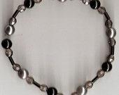 Delicate black and grey bracelet