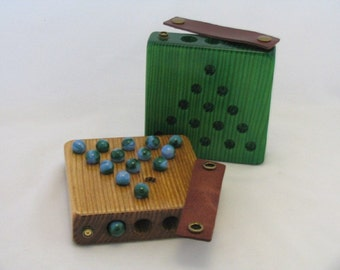 Solitaire Game that stores the marbles inside.