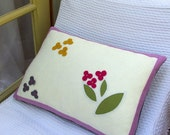 Wool felt pillow with lilac border and flowers