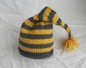 dark grey and yellow striped stocking hat
