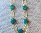 Malachite and goldtone link necklace