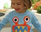 Orange Bernard the Monster Tee in L/S blue sizes kid 2,4,6, adult s/s, infant