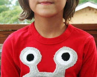 Grey Bernard Monster on long sleeve red tee, also available on short sleeve