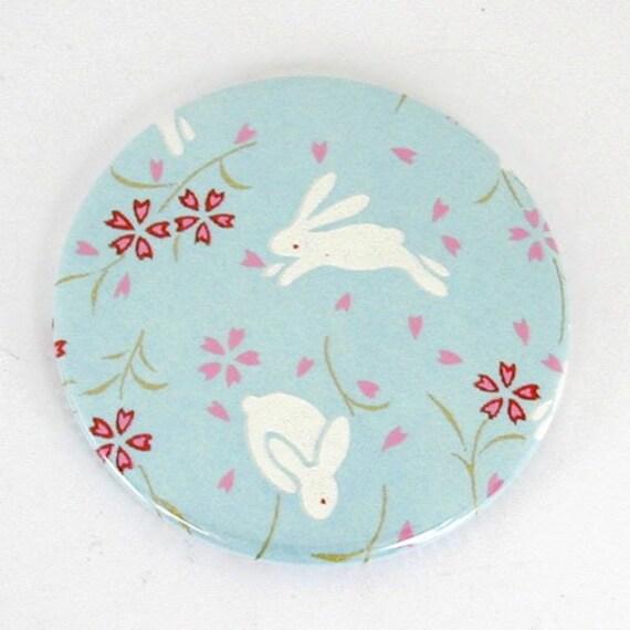 little white bunny on pale blue background japanese yuzen washi paper pocket mirror