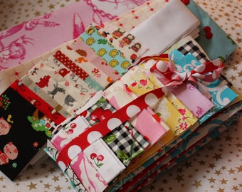 BABY QUILT KIT.  Colorway...Pink, red, and aqua.  Includes backing, batting, and binding.