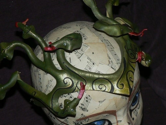 Medusa headpiece, in dark and light greens like the green mamba
