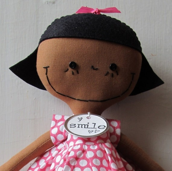handmade African American cloth rag doll Gabby in a Polka Dot Dress and Pink Striped Tights