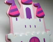 Pink and white princess castle wall electrical outlet safety plug
