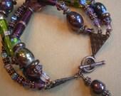 Purple Passion - lampwork glass and copper triple strand bracelet