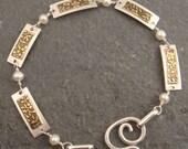 Silver and Brass Rectangular Bracelet with Garnet Beads
