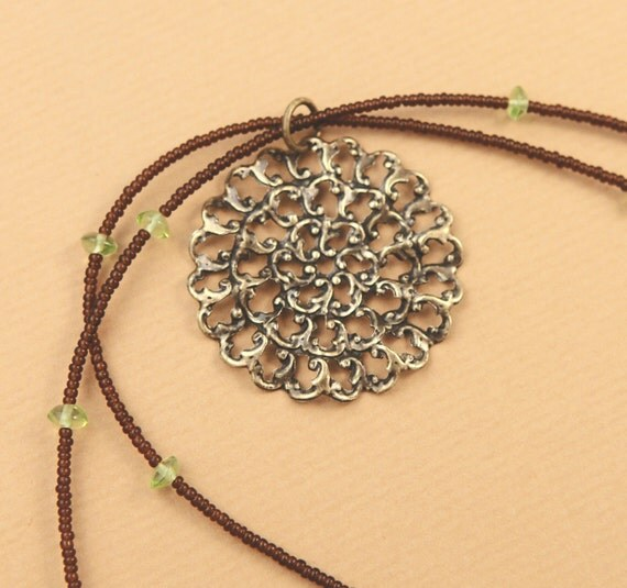 Delicate peridot and brown glass necklace