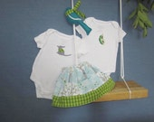 Baby girl gift set with reversible skirt and onesies to match
