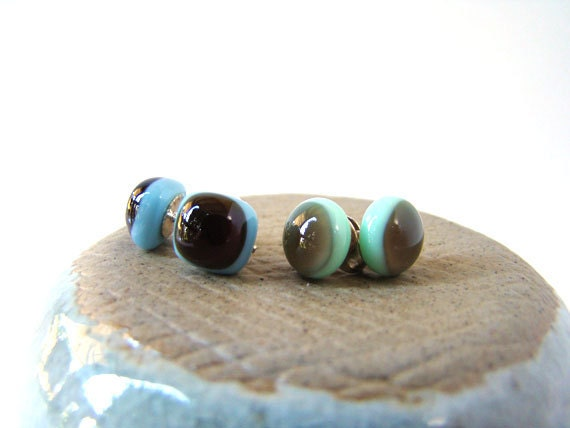 dark brown on blue studs and pale brown on pastel green studs