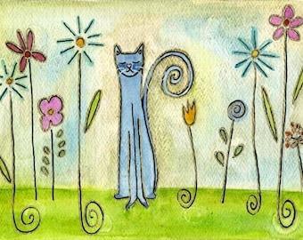 blue cat in flower garden