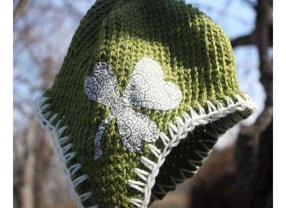 The Baby Shamrock Earflap Cap. Pea Green with Fabric Shamrock Embellishment. 9 to 18 months