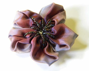 ribbon flower brooch in pale blue fading to navy with brown