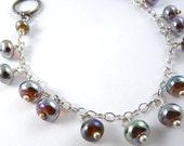 A Lovely Beaded Charm Bracelet Made with Little Handmade Aurae Glass Beads