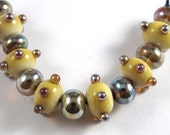 Six Handmade Micro Ivory Glass Beads with Aurae Accents