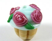 A Lovely Handmade Glass Vanilla Cupcake Bead with Mint Green Frosting and Pink Roses on Top