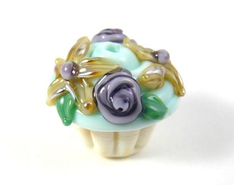 Adorable Handmade Glass Vanilla Cupcake Bead With Minty Green Frosting and Golden Aurae Flowers and Purple Roses