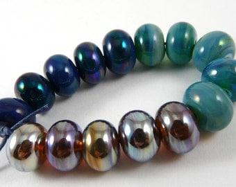 Set of Fifteen Kronos Gaia and Aurae Accent Handmade Glass Beads