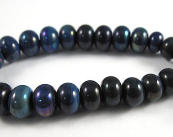 Set of Twenty Five Micro Kronos Handmade Glass Beads