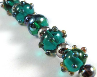 Free Shipping for this set of Handmade Teal Glass Beads with Aurae Accents