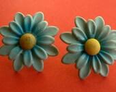blue metal flower studs