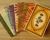 set of nine hand-printed cards, assorted