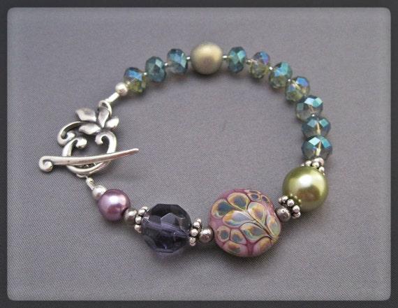 Handmade lampwork and Czech glass Bracelet. Purple, Teal, Green. Sterling Silver.