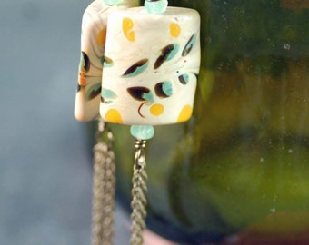 Hand-Painted Tassel Earrings Featuring Ceramic Beads in Cream with Green and Yellow Leaves and Seafoam Green Crystals