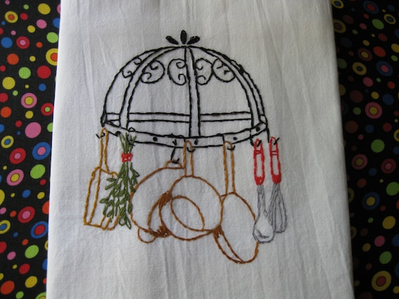 Shiny Copper Pot and Pans Handing from a Darling Black Wrought Iron Holder  Hand Embroidered Dish Towel