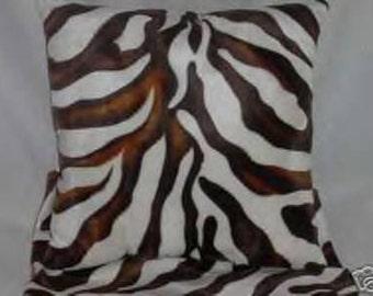 Two Brown and White Zebra Faux Fur Pillows