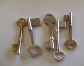 Vintage skeleton keys removed from the shop of a retired locksmaith medium size 5 pieces item 4137