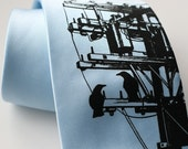 """Transformer """"Power Tie."""" Screenprinted sky blue necktie with birds, rabbits, wire, and electric pole. Choose  standard or narrow width."""
