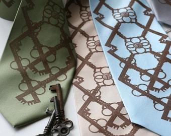 Argyle necktie. Interlocking skeleton key silkscreen tie. Bronze tartan print. Your choice of fabric color, sage green, sky blue & more.