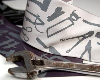 "Tool Tie. Handyman necktie. ""Weapons of Mass Construction"" men's necktie. Dove gray screenprint on your choice of tie colors."