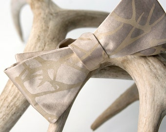 "Antler bow tie. Khaki / champagne self tie ""Stag Party"" bow tie. Silkscreened tan print."