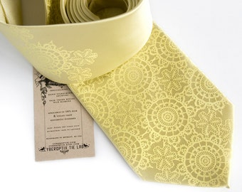 Cottage Lace, butter yellow silk necktie. Doily pattern screenprinted men's tie. Pale yellow tone on tone print.