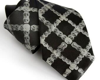 Tartan bicycle chain black necktie. Dove gray silkscreen print. Microfiber. Diamond bike chain tie. Choose standard, narrow or skinny.