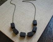 lava necklace in black statement cube design