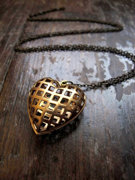 brass heart necklace in caged grid design on long chain