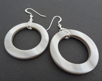 PLAYING HOOPS grey mother of pearl hoop earrings hung on sterling silver chains.  Modern and unique hoop earrings.