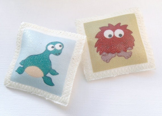 The Unexplained - Nessie and Bigfoot - Set of 2 Fabric Pin Back Buttons