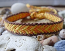 Orange and yellow friendship bracelet with brown edges