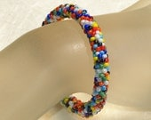 Beady Bangle ... Bead Crochet . Bracelet . Round . Multicolor . Colorful . Whimsical . Fun . Summery . Bright . Opaque . Rich Colors