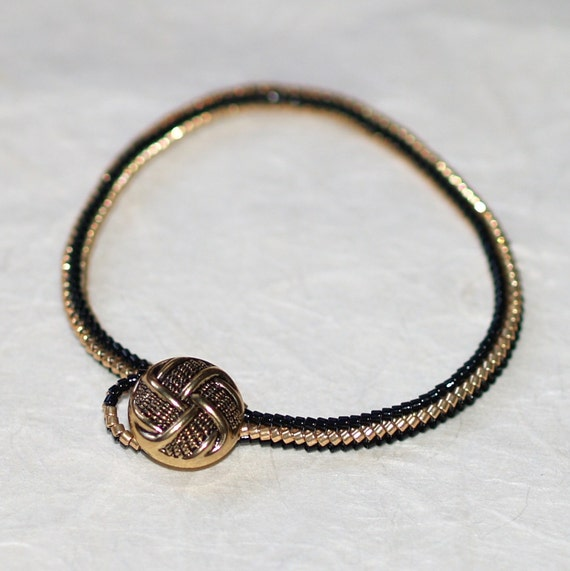 Button It ... Bracelet . Ndebele Rope . Skinny . Shiny Black . Metallic Gold . Basketweave . Vintage Button . Simple . Mod . Stylish . Chic