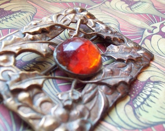 Victorian sash brooch citrine glass flame orange brass